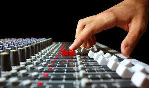 finger on mixer fader