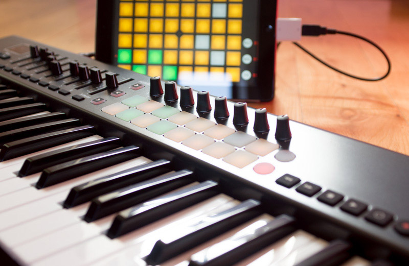 The Novation Launchkey series provide a good range of extra controls depending upon the exact model in the range.